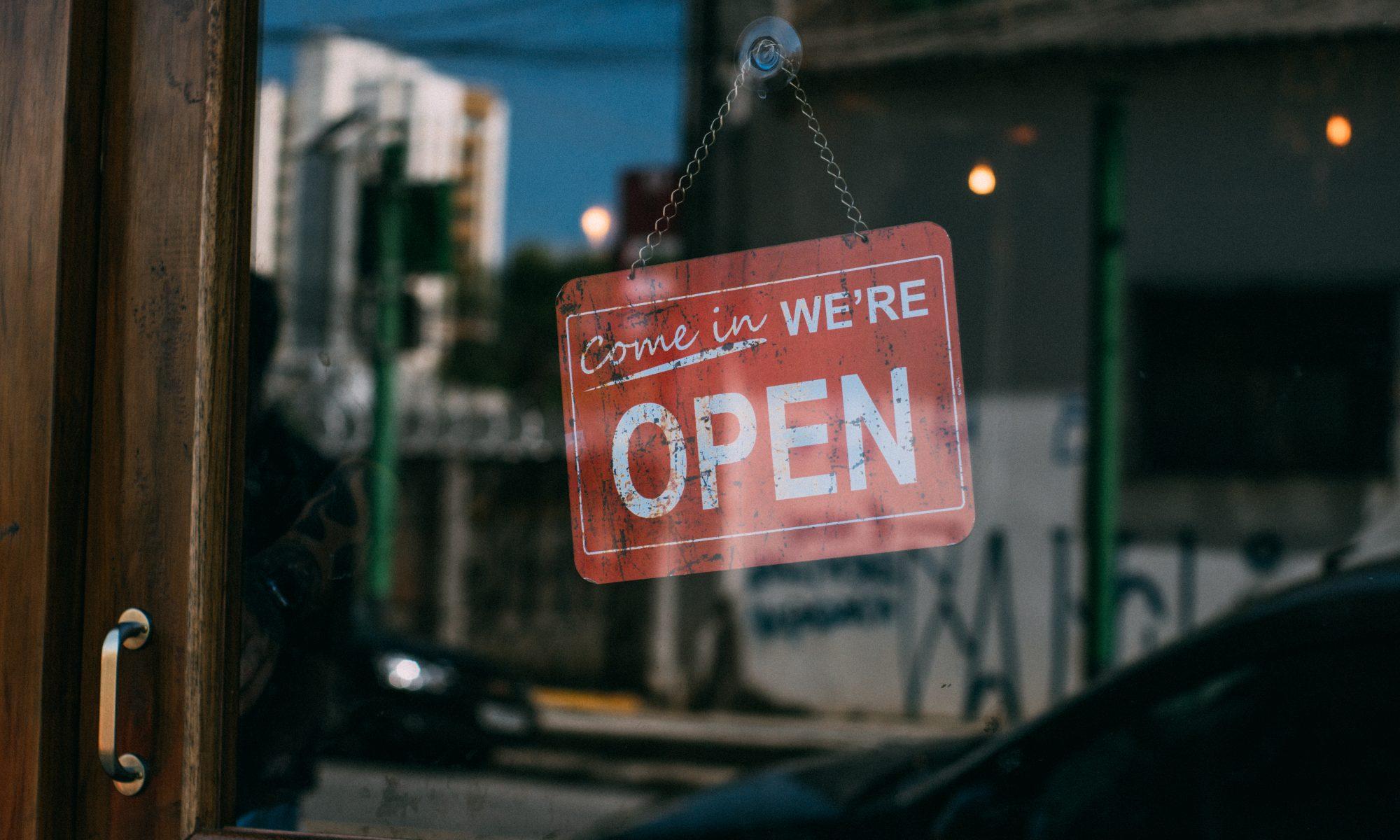 Open sign in a glass door